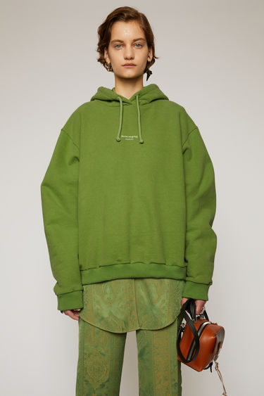Acne Studios forest green hooded sweatshirt is made from cotton jersey that has been garment dyed for a soft, washed-out finish. It's cut to an oversized fit and features a reversed logo printed across the chest.