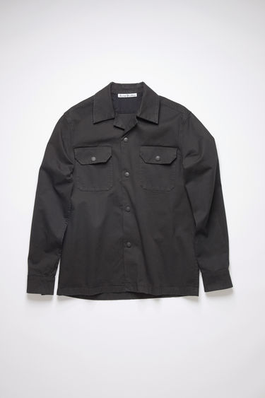Acne Studios black long sleeve, boxy shirt is made of cotton with a slight stretch.