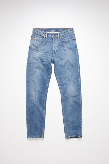 Acne Studios mid blue jeans are made from from comfort stretch denim with a high rise and a slim, tapered leg.