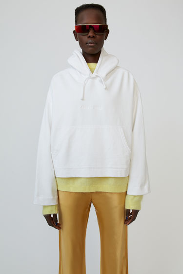 Acne Studios Joghy optic white hooded sweatshirt is shaped for an oversized fit and accented with an embossed logo.