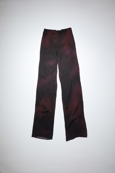 Acne Studios black/fuchsia pink trousers are made of printed silk chiffon with a classic fit.