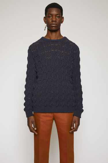 Acne Studios dark navy sweater knitted from cotton blend to a cable pattern and completed with a ribbed crew neck, cuffs and hem.