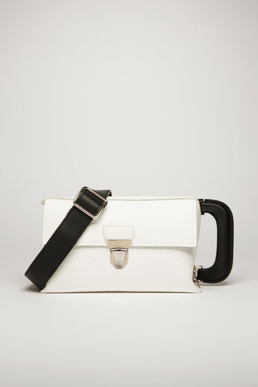 Acne Studios white satchel is crafted to a boxy silhouette from grain leather and has silver-tone branded hardware and a contrasting tape on the side panel.