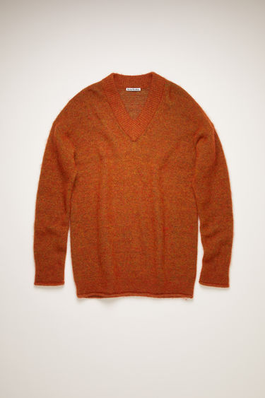 Acne Studios pumpkin orange sweater is crafted from soft alpaca and wool-blend to a relaxed silhouette with a deep v-neckline and finished with rolled edges around the ribbed cuffs and hem.