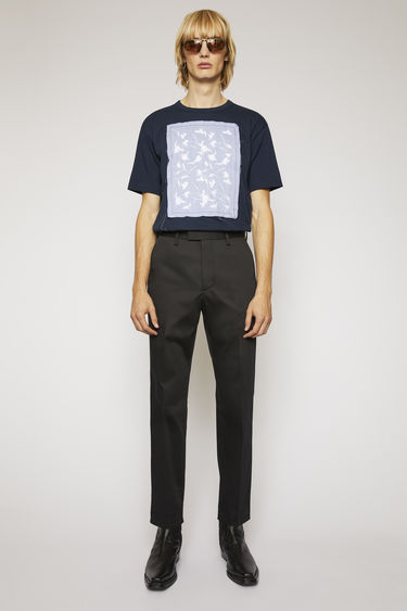 Acne Studios black trousers are cut from stretchy cotton twill with straight, slim legs and finished with pockets at front and back.
