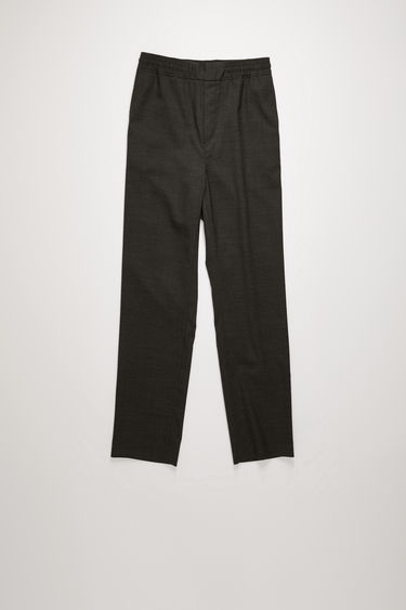 Acne Studios dark grey melange wool trousers are shaped with straight legs with a cropped length and finished with an elasticated waistband with a flat front panel.