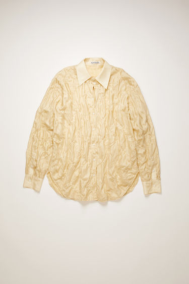 Acne Studios cream beige shirt is crafted from lightweight silk habotai to a relaxed shape and features quilting on front and back.