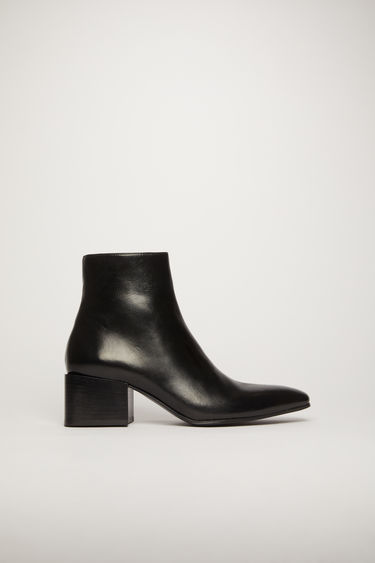 Acne Studios black patent leather ankle boots.