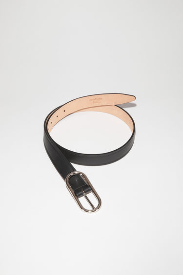 Acne Studios black leather belt is crafted to a slender silhouette with a tapered tip and has a discreet engraved logo on the oval-shaped buckle.