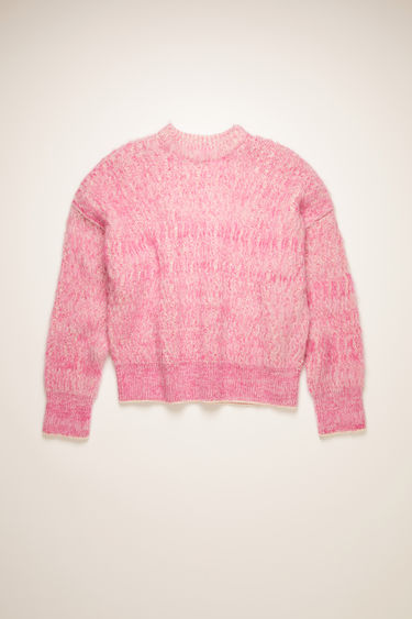 Acne Studios pink/white melange sweater is knitted in a wavy variation of the traditional ribbed pattern then brushed to a soft handle. It's shaped to an oversized silhouette with dropped shoulders and finished with thick ribbed edges at the crew neck, cuffs, and hem.
