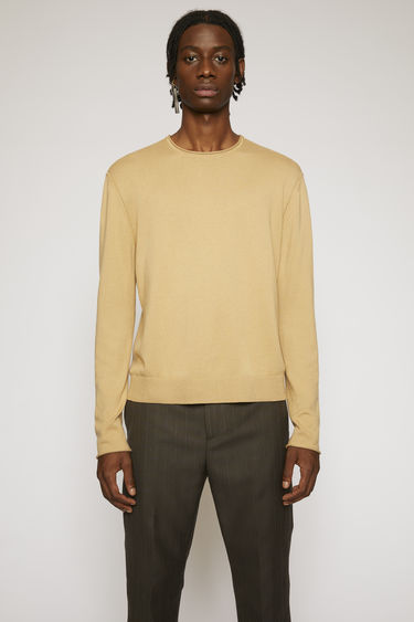Acne Studios ecru beige sweater is knitted from soft Japanese cotton and features rolled edges on the cuffs, hem and neck.