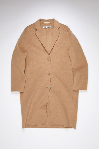 Acne Studios camel melange single-breasted coat is made of wool with a classic fit.
