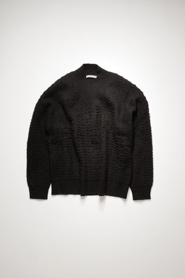 Acne Studios black sweater is knitted from cotton-blend yarn then brushed to enhance the textured pattern. It's crafted with dropped shoulder and finished with ribbed trims along the v-neck, cuffs and hem.