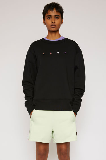 Acne Studios black sweatshirt is crafted from midweight brushed jersey and accented with animal pins across the front.