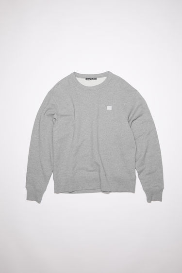 Acne Studios light grey melange crew neck sweatshirt is made of organic cotton with a face patch and ribbed details.