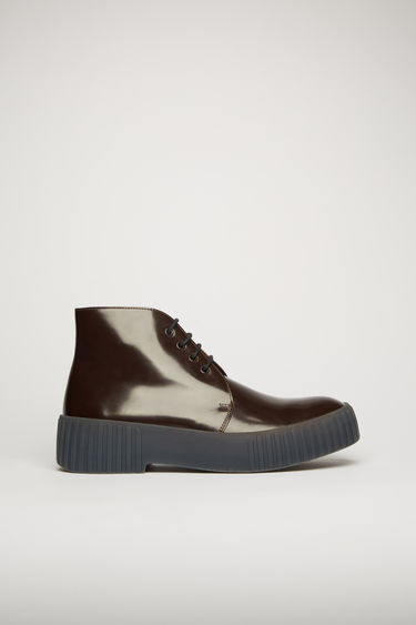 Acne Studios burgundy/grey shoes are shaped to a classic chukka silhouette. They're crafted from polished leather to a high-top silhouette and set on a chunky ribbed-rubber sole.