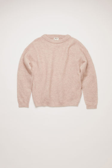 Acne Studios Dramatic Mohair powder pink sweater is shaped for an oversized fit. It's knitted with elements of soft wool and mohair, and finished with classic ribbed trims.