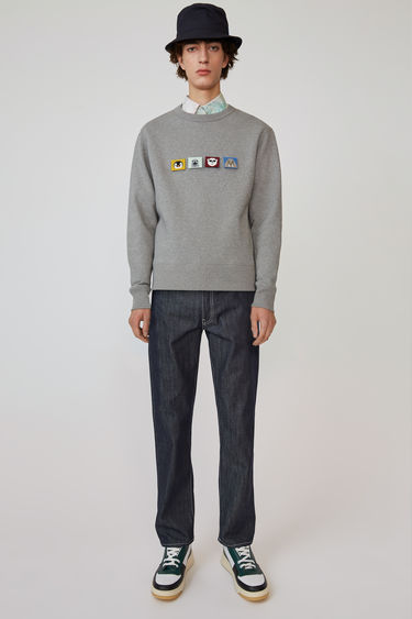 Acne Studios indigo blue 5-pocket jeans are cut to a straight fit and accented with a face patch on the back pocket.