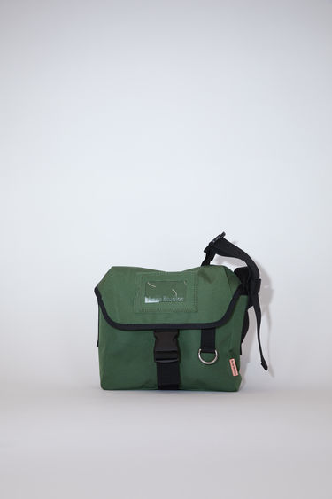 Acne Studios dark green brightly coloured crossbody bag features a clear cardholder on the front and Acne Studios logo.
