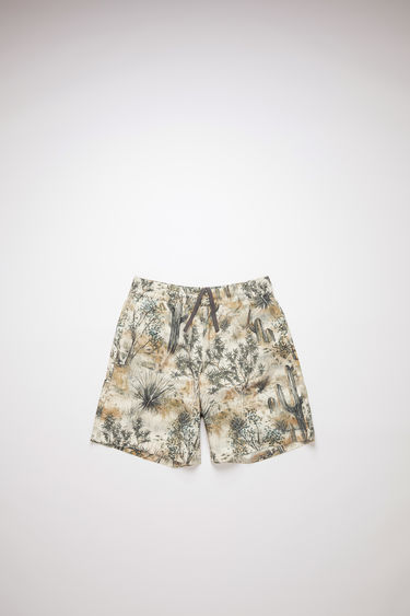 Acne Studios desert beige printed swim trunks have pockets and a relaxed fit.