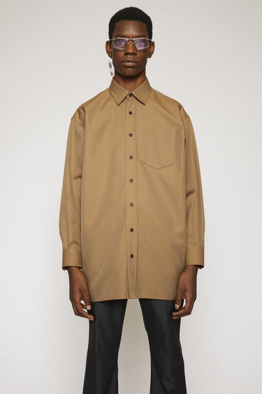 Acne Studios mushroom beige oversized shirt is crafted from a cotton-blend twill with a subtle lustre finish and finished with a patch pocket on the chest.