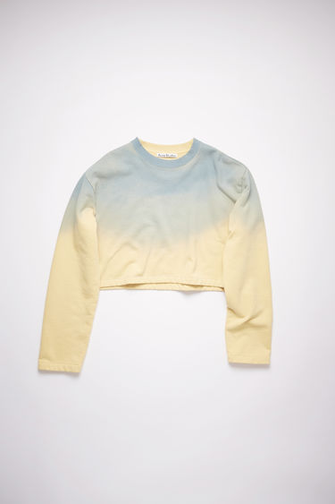 Acne Studios vanilla yellow/pale blue crew neck sweatshirt is made of cotton with a hand-applied spray treatment.