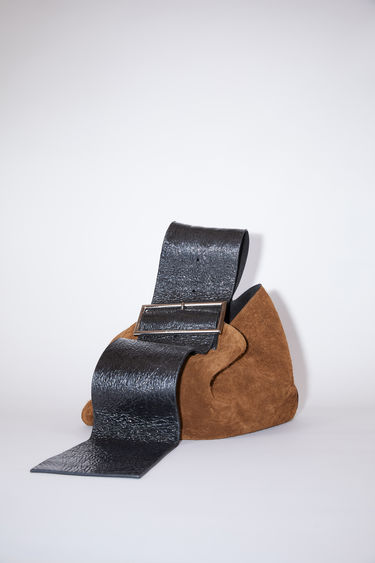 Acne Studios brown/black bucket bag is made of suede.