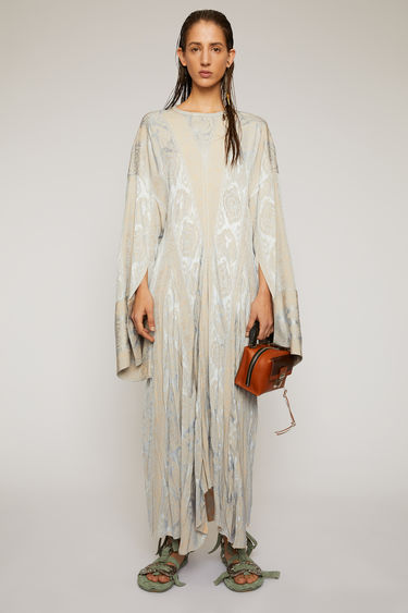 Acne Studios blue/cream dress is crafted from satin viscose that's jacquard-woven with a paisley pattern and features a gathered cut-out panel with knotted ties, draping loosely at the back.