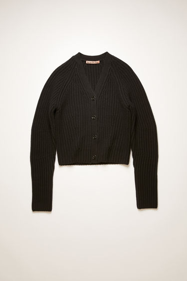Acne Studios black cardigan is knitted from wool in a chunky ribbed pattern. It's accented with a fully fashioned v-neck, shoulders and rounded sleeves to define the waist.