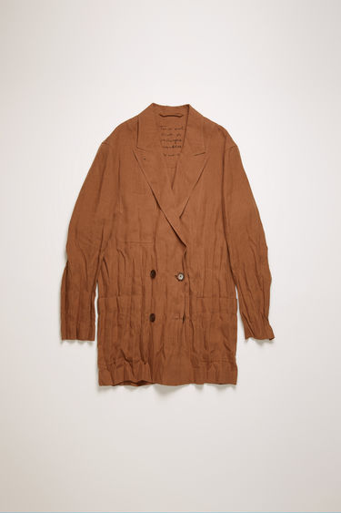 Acne Studios mink brown double-breasted jacket is crafted from creased linen with peak lapels and patch pockets and features an embroidered care instruction label at back neck.