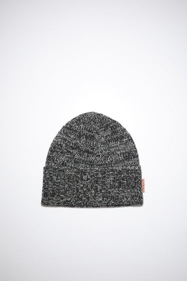 Acne Studios black/white beanie is knitted from a blend of melange wool yarns in a chunky ribbed pattern and neatly framed with a turn-up brim.