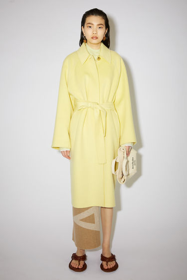 Acne Studios vanilla yellow belted coat is made of a wool/alpaca blend with two large welt pockets and double face finishings.