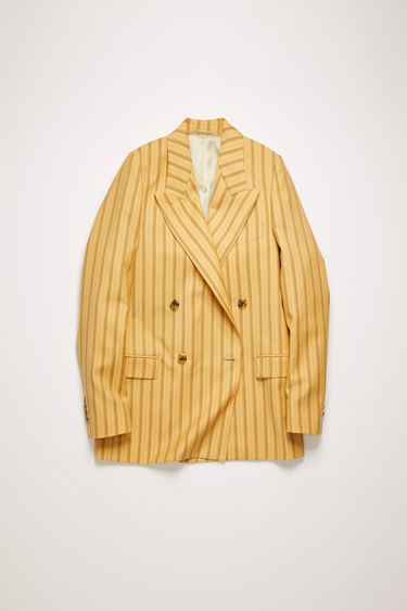 Acne Studios pale orange suit jacket is crafted from pinstriped wool and shaped to a double-breasted silhouette with lightly padded shoulders and wide lapels.