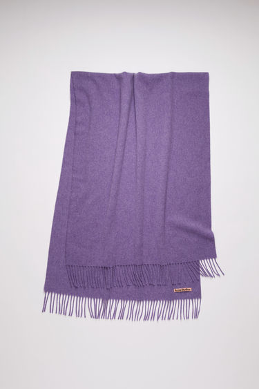 Acne Studios lilac purple oversized fringed scarf is made of pure wool, featuring a label in one corner.