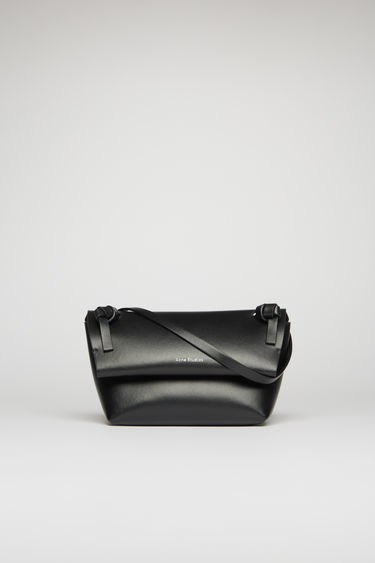 Acne Studios black mini purse is crafted from soft cow leather and detailed with an obi-inspired knot on each end of the crossbody strap.