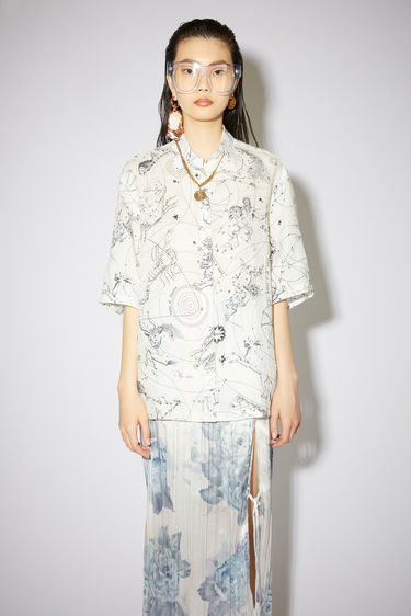 Acne Studios white printed shirt has a relaxed fit with button closures.