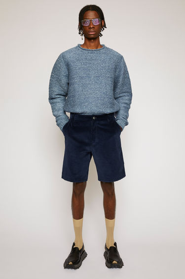 Acne Studios navy shorts are cut from soft corduroy with a high-rise waist and straight legs and finished with wide belt loops and round patch pockets.
