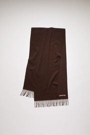 Acne Studios Canada Nr New brown melange scarf is crafted from pure wool and finished with fringed edges and a label across one corner.