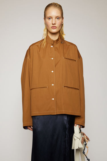 Acne Studios antique brown overshirt is crafted from washed cotton poplin to a boxy silhouette and features a mandarin collar and jet pockets with contrasting white topstitching along the seams.