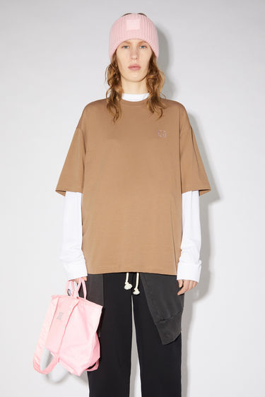 Acne Studios antique brown cotton jersey t-shirt features a rhinestone face at the chest and diamond print on the back.