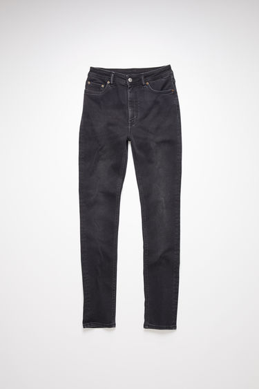 Acne Studios used black jeans are made from super stretch denim with a high rise and a skinny leg.