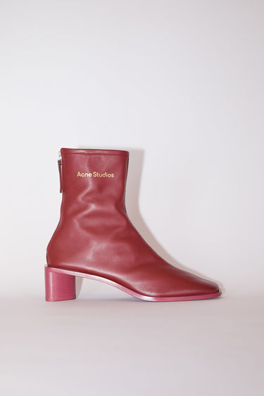 Acne Studios burgundy/burgundy square toe booties are made of leather with Acne Studios branding.