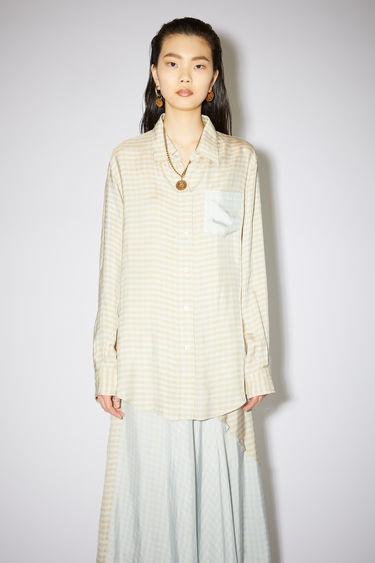 Acne Studios beige/peach long sleeve shirt is made of viscose, featuring a subtle check and contrasting pocket