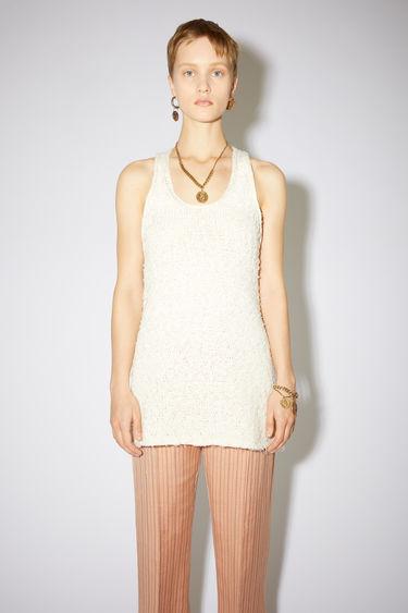 Acne Studios white feathery tank top is made of a cotton blend with a long, relaxed fit.