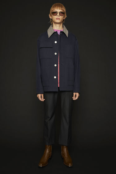 Acne Studios navy jacket is cut from cotton twill to a boxy silhouette and accented with a tweed point collar and silver-tone branded buttons.