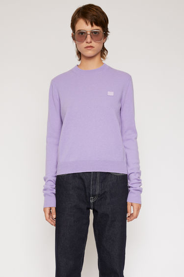 Acne Studios lavender purple sweater is finely knitted from pure wool and finished with a tonal face-embroidered patch and ribbed trims.