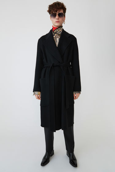 Acne Studios Carice Doublé black is a long, belted double coat with an easy fit.