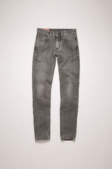 Acne Studios North Dark Stone Grey jeans are crafted from comfort stretch denim that's stonewashed to give a worn-in appeal. They're shaped for a slender fit with slim legs and a mid-rise waist.