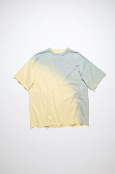 Acne Studios vanilla yellow/pale blue crew neck t-shirt is made of cotton with a hand-applied spray treatment.