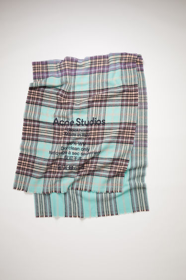 Acne Studios light blue/lilac tartan check scarf is made of wool with a large, printed care label.